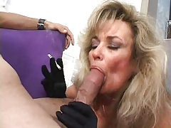 Mature in black gloves blows and smokes tubes