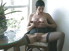 Busty milf vibrates her pussy with toy tubes