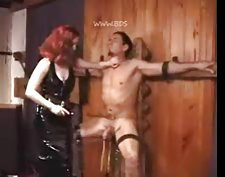 Redhead mistress makes sure he suffers tubes