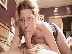 Woman in glasses deepthroats long cock tubes