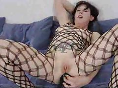 Mature stretches ass with huge toy tubes