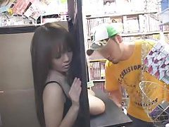 Girl in convenience store shows tits to customers tubes