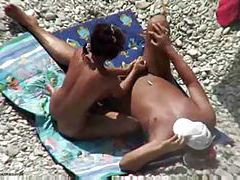 Giving him a handjob at the beach tubes