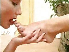 Girl licks feet and takes piss in mouth tubes