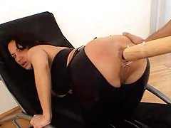 Girl in black latex takes bat in ass tubes