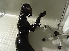 Latex bodysuit and a gas mask tubes