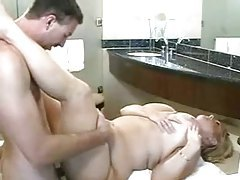 Fat blonde with enormous tits in sex scene tubes