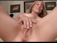 Mature chick playing with pussy on camera tubes