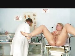 Doctor examines the chubby older babe tubes