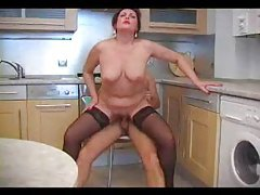 Mature chick blowing and fucking in kitchen tubes