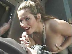 Chick on her knees by the car sucking tubes