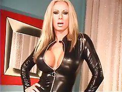Perfect pornstar modeling a black leather catsuit tubes