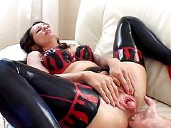 Chick in latex double fisted tubes