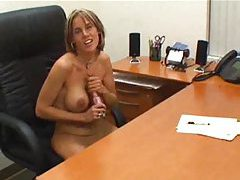Secretary at desk gives POV handjob tube