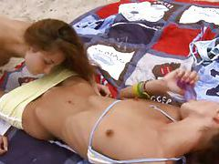 Brunettes playing on the beach tubes