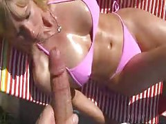 Blonde in pink bikini gives handy tubes
