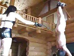 Mistress whips slave hanging upside down tubes