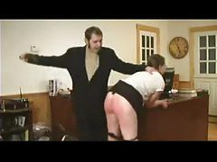 Cute girl in glasses cries out during spanking tubes