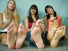 Three girls modeling feet and talking tubes