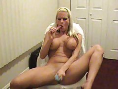 Blonde with an amazing body uses toys tubes