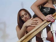 Latex fetish lesbian fun on the stairs tubes