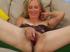 Mature in black lingerie toys her fresh cunt tubes