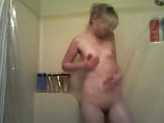 Cute blonde masturbates in shower tubes
