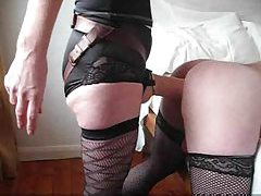 Sissy in stockings takes big strapon tubes