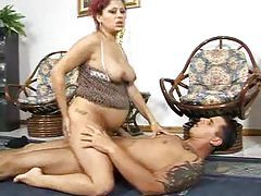 Preggo redhead Latina is sitting on dick tubes