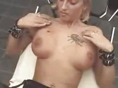 Sticking needles into her tits tubes