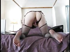 Girl in fishnet stockings masturbating tubes