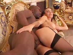 Slowly cramming her ass with black cock tubes