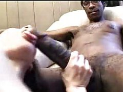 She orally works the monstrous black cock tubes