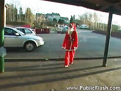 Santa girl doing a striptease on camera tubes