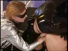 Latex fetish group scene with fisting tubes