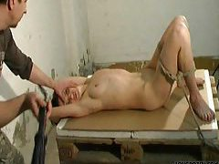 Tied girl experiences pain for her body tubes