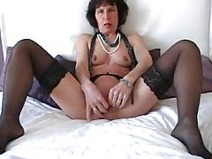 Mature in stockings masturbates her cunt tubes