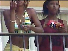 Black lesbians kissing on hotel balcony tube