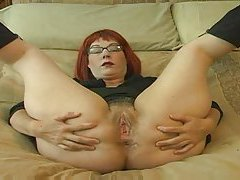 Redhead in glasses talking dirty tubes