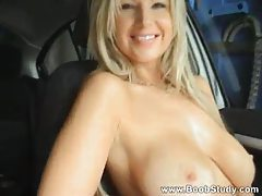 Flashing her big tits in the car tubes