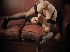 Marvelous girl in stockings plays with toy tubes