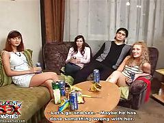 Drunken teen servicing guys at party tubes