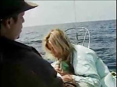 Babe on a boat sucking a hot cock tubes