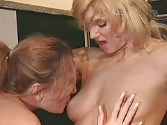 Lesbians get it on in the kitchen tubes