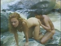 Hot fuck in the jungle with a river behind them tubes