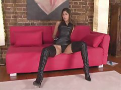 Girl in lots of leather touching sensually tubes