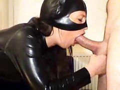 Chick in latex catsuit gives head until he cums tubes