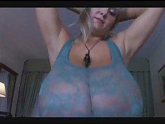 Girl with humongous natural tits modeling them tubes