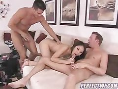 Slender chick entertains two guys at once tubes