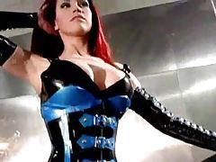 Redhead posing solo in great rubber tubes
